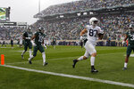 Penn State's Pat Freiermuth (87) runs in for a touchdown on a pass reception against Michigan State's Josh Butler (19), Tre Mosley (17) and Xavier Henderson, right, during the first quarter of an NCAA college football game, Saturday, Oct. 26, 2019, in East Lansing, Mich. (AP Photo/Al Goldis)