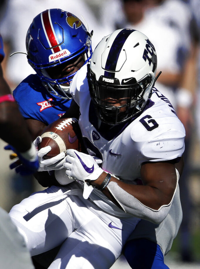 TCU running back Darius Anderson (6) his tackled by Kansas defensive end Azur Kamara, left, during the first half of an NCAA college football game in Lawrence, Kan., Saturday, Oct. 27, 2018. (AP Photo/Orlin Wagner)