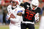 SMU wide receiver James Proche (3) turns into the end zone to score on a reception in front of Houston safety Gervarrius Owens (32) during the first half of an NCAA college football game Thursday, Oct. 24, 2019, in Houston. (AP Photo/Michael Wyke)