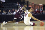 Harvard guard Noah Kirkwood (10) gains control of a loose ball in front of Texas A&M guard Jay Jay Chandler III (0) during the second half of an NCAA college basketball tournament game Thursday, Nov. 28, 2019, in Lake Buena Vista, Fla. (AP Photo/Phelan M. Ebenhack)