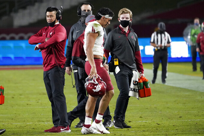 Washington State quarterback Jayden de Laura (4) walks off the field after an injury during the second half of an NCAA college football game against Southern California in Los Angeles, Sunday, Dec. 6, 2020. (AP Photo/Alex Gallardo)