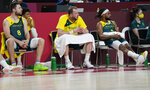 Australia players watch from the bench during men's basketball semifinal game between the United States and Australia at the 2020 Summer Olympics, Thursday, Aug. 5, 2021, in Saitama, Japan. (AP Photo/Eric Gay)