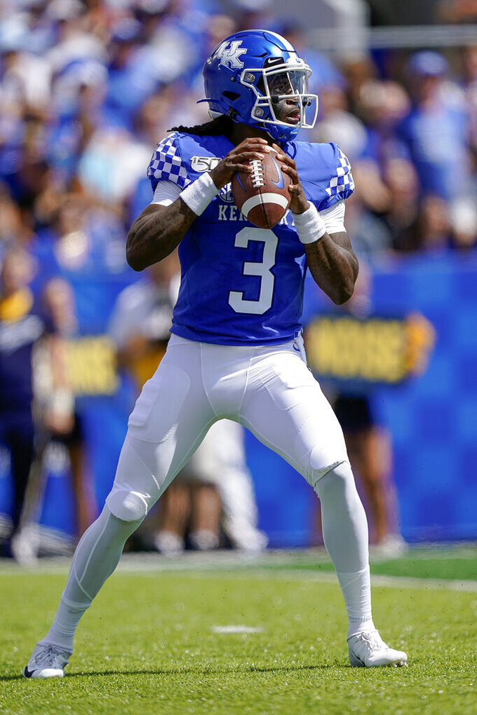 Kentucky quarterback Terry Wilson (3) drops back to pass during the first half of the NCAA college football game against Toledo, Saturday, August 31, 2019, in Lexington, Ky. (AP Photo/Bryan Woolston)