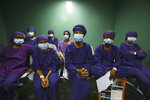 "Nepalese patients wait to receive anesthesia before eye surgery at the Tilganga Eye Center in Kathmandu, Nepal, Friday, March 26, 2021. Nepal's ""God of Sight"" eye doctor renowned for his innovative and inexpensive cataract surgery for the poor is taking his work beyond the Himalayan mountains to other parts of the world so there is no more unnecessary blindness in the world. Dr. Sanduk Ruit, who has won many awards for his work and performed some 130,000 cataract surgery in the past three decades, is aiming to expand his work beyond the borders of his home country and the region to go globally. (AP Photo/Niranjan Shrestha)"