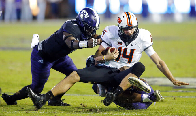 TCU gets bowl eligible again with 31-24 win over Oklahoma St