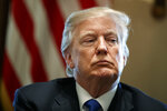 FILE- In this Jan. 9, 2018, file photo, President Donald Trump listens during a meeting with lawmakers on immigration policy in the Cabinet Room of the White House in Washington. Trump used profane language Thursday, Jan. 11, as he questioned why the U.S. should permit immigrants from certain countries, according to three people briefed on the conversation. The White House did not deny the comment. (AP Photo/Evan Vucci, File)