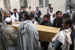 Men carry the coffin of a local victim of a gun attack on a Japanese aid worker's vehicle in the city of Jalalabad east of Kabul, Afghanistan, Wednesday, Dec. 4, 2019. Japanese physician and aid worker Tetsu Nakamura has died of his wounds after an attack that also killed five Afghans, including the doctor's bodyguards, the driver and a passenger. (AP Photo/Wali Sabawoon)