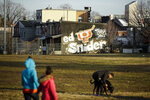 In this Feb. 21, 2019 photo a mural dedicated to Ed Snider is seen on the side of a home near the Scanlon Ice Rink in Philadelphia. Snider Hockey, the foundation late Flyers owner Ed Snider started in 2005 and provides free equipment, ice time and academic support for more than 3,000 students. (AP Photo/Matt Rourke)