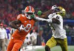 Clemson wide receiver Justyn Ross (8) fights off a tackle attempt by Notre Dame safety Jalen Elliott (21) and gets into the end zone for a touchdown in the first half of the NCAA Cotton Bowl semi-final playoff football game, Saturday, Dec. 29, 2018, in Arlington, Texas. (AP Photo/Jeffrey McWhorter)