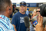 FILE - In this July 28, 2018, file photo, Dallas Cowboys offensive coordinator Scott Linehan talks with the media after morning practice at NFL football training camp, in Oxnard, Calif. Scott Linehan is out as offensive coordinator of the Dallas Cowboys only days after coach Jason Garrett sent mixed messages about the oft-criticized assistant's future. Garrett said in a statement released by the team Friday, Jan. 18, 2019, that he and Linehan had some open discussions this week and mutually agreed that a change was needed after five seasons. (AP Photo/Gus Ruelas, File)