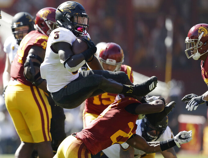 Arizona State running back Eno Benjamin (3) leaps over Southern California cornerback Ajene Harris during the first half of an NCAA college football game Saturday, Oct. 27, 2018, in Los Angeles. (AP Photo/Marcio Jose Sanchez)