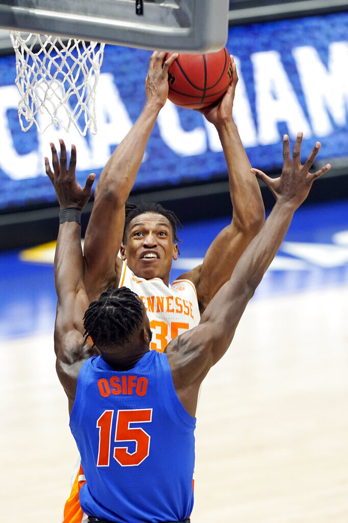 Tennessee's Yves Pons (35) shoots against Florida's Osayi Osifo (15) in the second half of an NCAA college basketball game in the Southeastern Conference Tournament Friday, March 12, 2021, in Nashville, Tenn. (AP Photo/Mark Humphrey)