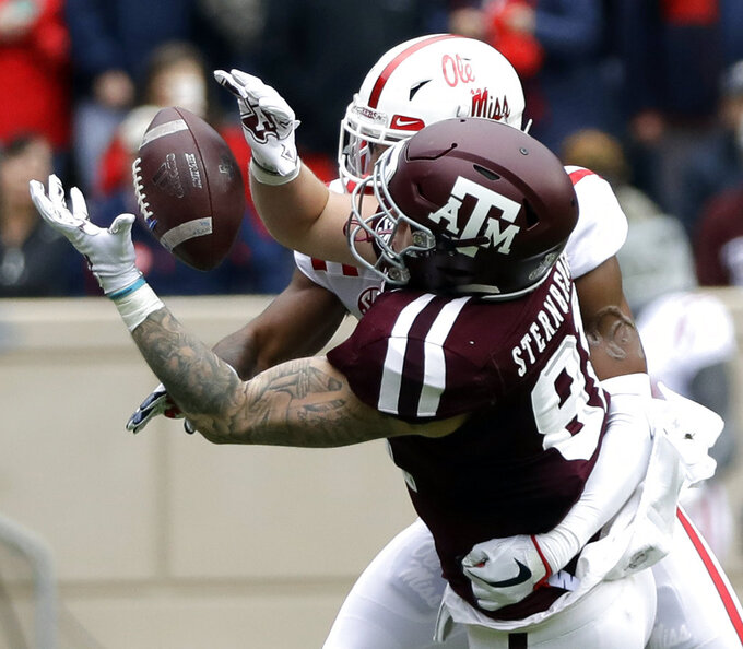 FILE - In this Nov. 10, 2018, file photo, Texas A&M tight end Jace Sternberger (81) catches a pass for a first down as Mississippi defensive back Myles Hartsfield defends during the first half of a game in College Station, Texas. Sternberger was named to the 2018 AP All-America NCAA college football team, Monday, Dec. 10, 2018.(AP Photo/David J. Phillip, File)
