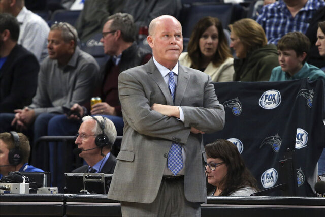 Orlando Magic's head coach Steve Clifford watches his team early in the second half before leaving an NBA basketball game and being replaced by Tyrone Corbin in the second half against the Minnesota Timberwolves, Friday, March 6, 2020, in Minneapolis. (AP Photo/Jim Mone)
