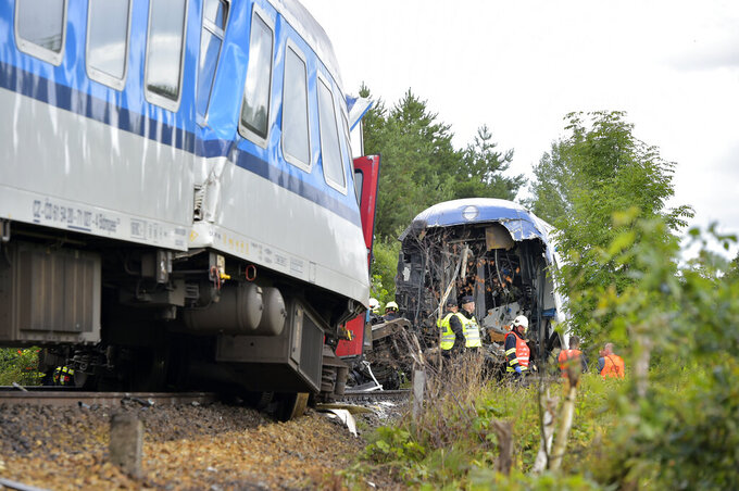The Western Express Train collided with a passenger train near the village of Milavce between the stations Domazlice and Blizejov, Czech Republic, Wednesday, Aug. 4, 2021. Two people died in the accident, 38 people were injured, seven of them are in critical condition. (CTK Photo via AP/Miroslav Chaloupka)