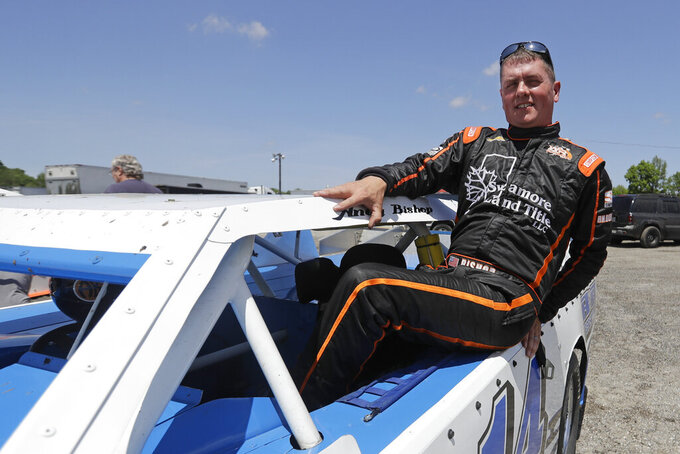Andy Bishop climbs out of his car following a practice session at Gas City I-69 Speedway, Sunday, May 24, 2020, in Gas City, Ind. On a day usually reserved for IndyCar's crown jewel race, Gas City I-69 Speedway an hour's north of Indianapolis had a handful of cars on a short dirt track. (AP Photo/Darron Cummings)