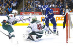Toronto Maple Leafs' Auston Matthews (34) scores on Minnesota Wild goaltender Devan Dubnyk (40) during the second period of an NHL hockey game Tuesday, Oct. 15, 2019, in Toronto. (Chris Young/The Canadian Press via AP)