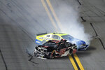 Daniel Suarez (96) and Ryan Blaney (12) collide along the front stretch after coming out of Turn 4 during the first of two NASCAR Daytona 500 qualifying auto races at Daytona International Speedway, Thursday, Feb. 13, 2020, in Daytona Beach, Fla. (AP Photo/Phelan M. Ebenhack)