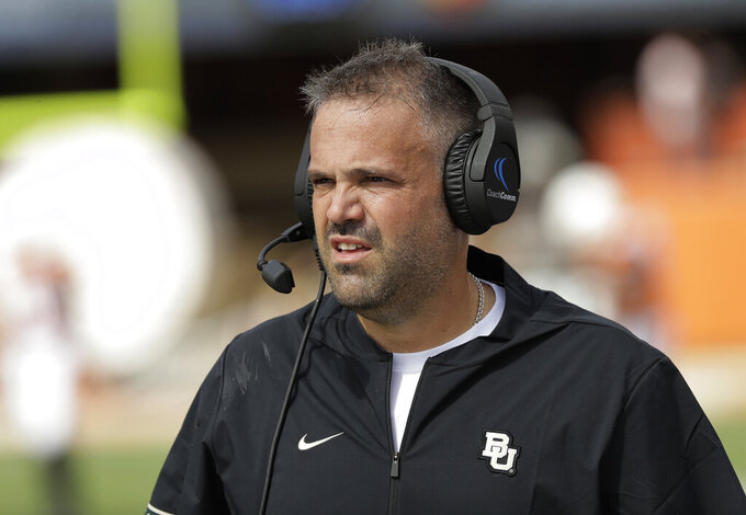 FILE - In this Oct. 13, 2018, file photo, Baylor head coach Matt Rhule watches from the sideline during the first half of an NCAA college football game against Texas, in Austin, Texas. Rhule may have only been joking when he said he sometimes still wakes up in the middle of the night haunted by the memory of those highlight plays TCU's Jalen Reagor made against the Bears last season. But that was in the last loss for the Bears, when Reagor pretty much single-handedly beat them by turning a screen pass into a 65-yard touchdown and running 37 yards for a score on a fourth-and-1 reverse. (AP Photo/Eric Gay, File)