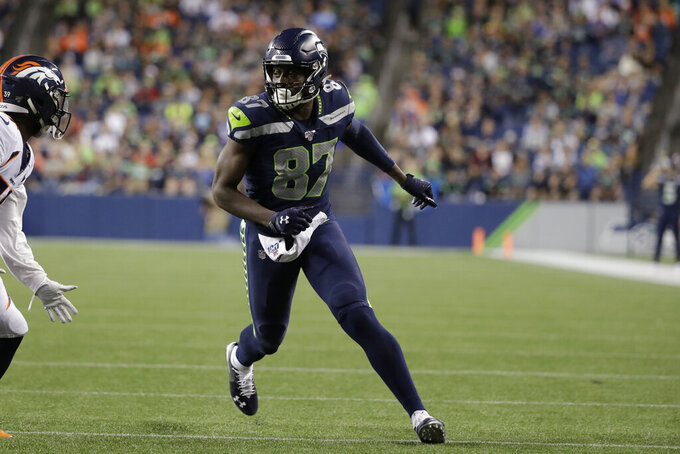 Seattle Seahawks wide receiver Jazz Ferguson (87) runs a route against the Denver Broncos during the second half of an NFL football preseason game Thursday, Aug. 8, 2019, in Seattle. (AP Photo/Elaine Thompson)