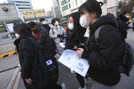 Students arrive to take the college entrance exam at a high school in Seoul, South Korea, Thursday, Dec. 3, 2020. South Korean officials urged on Wednesday people to remain at home if possible and cancel gatherings as about half a million students prepare for the crucial national college exam. (AP Photo/Ahn Young-joon)