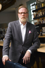 John Stephenson poses, Wednesday, Aug. 18, 2021, at the restaurant Hathorne which he owns, in Nashville, Tenn. Stephenson hosts other restaurants, known as pop-ups, which he lets use his space in an effort to help them weather the pandemic. (AP Photo/John Amis)