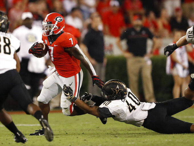 Georgia running back D'Andre Swift (7) tries to break away from Vanderbilt linebacker Jordan Griffin (40) during the second half of an NCAA college football game Saturday, Oct. 6, 2018, in Atlanta. (AP Photo/John Bazemore)