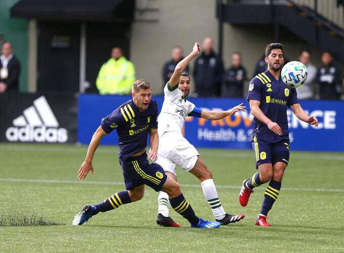 File-Portland Timbers' Diego Valeri, center, shoots for a goal against Nashville SC in an MLS soccer match in Portland, Ore., Sunday, March 8, 2020. Having watched the MLS is Back tournament from afar because of coronavirus cases, FC Dallas and Nashville SC are grateful for the chance to play when they meet Wednesday, Aug. 12, 2020, for the resumption of Major League Soccer's regular season.(Sean Meagher/The Oregonian via AP, File)
