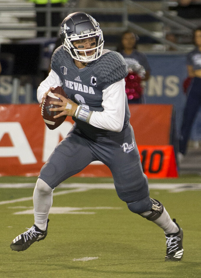 Nevada quarterback Ty Gangi (6) rolls out against San Diego State in the second half of an NCAA college football game in Reno, Nev., Saturday, Oct. 27, 2018. (AP Photo/Tom R. Smedes)