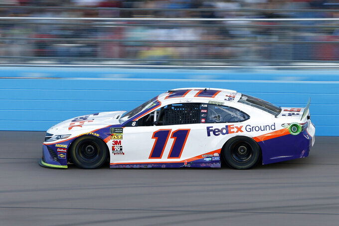 Denny Hamlin drives through Turn 4 during a NASCAR Cup Series auto race at ISM Raceway, Sunday, Nov. 10, 2019, in Avondale, Ariz. Hamlin went on to win the race. (AP Photo/Ralph Freso)