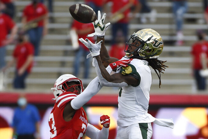 South Florida wide receiver Latrell Williams, right, catches a pass as Houston cornerback Art Green defends during the second half of an NCAA college football game, Saturday, Nov. 14, 2020, in Houston. (AP Photo/Eric Christian Smith)