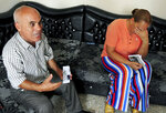 Imed Helel and his wife Kalthoum Helel talk to The Associated Press in Ras Jebel, near Bizerte, Tunisia, Wednesday, Sept. 23, 2020. The parents fear their son Ghofrane who left Tunisia for Italy last September at the age of 20 was lost at sea. The number of Tunisians migrating clandestinely to Italy has risen to levels not seen since the 2011 Arab Spring uprising. That's causing tensions in Italy's south, where more than 2,200 migrants are quarantining on ferries anchored offshore.  (AP Photo/Hassene Dridi)