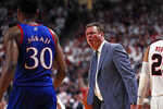 Kansas coach Bill Self yells at Ochai Agbaji (30) after he let the ball go out of bounds during the second half of an NCAA college basketball game against Texas Tech, Saturday, March 7, 2020, in Lubbock, Texas. (AP Photo/Brad Tollefson)