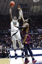 Purdue forward Trevion Williams (50) shoots over Minnesota center Daniel Oturu (25) during the second half of an NCAA college basketball game in West Lafayette, Ind., Sunday, Feb. 3, 2019.  (AP Photo/Michael Conroy)