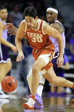 Texas forward Brock Cunningham (30) steals the ball in front of Kansas State forward Xavier Sneed, back, during the first half of an NCAA college basketball game in Manhattan, Kan., Saturday, Feb. 22, 2020. (AP Photo/Orlin Wagner)
