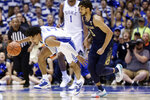 Duke guard Tre Jones (3) dribbles while Notre Dame guard Prentiss Hubb pursues during the second half of an NCAA college basketball game in Durham, N.C., Saturday, Feb. 15, 2020. (AP Photo/Gerry Broome)