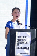 Climate activist Greta Thunberg speaks after a student-led climate change march in Los Angeles, on Friday, Nov. 1, 2019. Thunberg says young people are rallying to fight climate change because their age leaves them with the most to lose from damage to the planet. (AP Photo/Ringo H.W. Chiu)