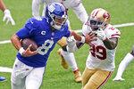 New York Giants quarterback Daniel Jones (8) tries to keep San Francisco 49ers' Jaquiski Tartt away during the second half of an NFL football game, Sunday, Sept. 27, 2020, in East Rutherford, N.J. (AP Photo/Corey Sipkin)