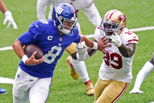 New York Giants quarterback Daniel Jones (8) tries to keep San Francisco 49ers' Jaquiski Tartt away during the second half of an NFL football game, Sunday, Sept. 27, 2020, in East Rutherford, N.J. (AP Photo/Corey Sipkin)