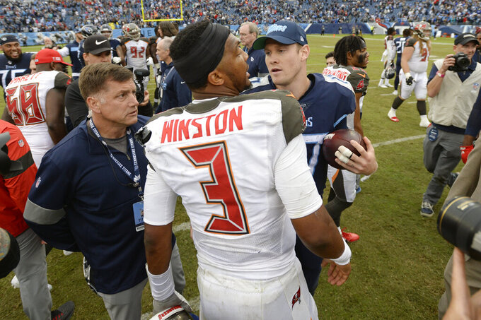 Tampa Bay Buccaneers quarterback Jameis Winston (3) talks with Tennessee Titans quarterback Ryan Tannehill after an NFL football game Sunday, Oct. 27, 2019, in Nashville, Tenn. The Titans won 27-23. (AP Photo/Mark Zaleski)
