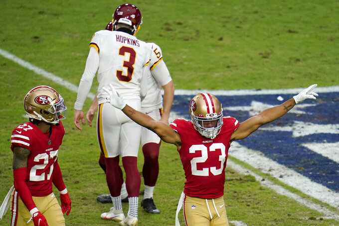 San Francisco 49ers cornerback Ahkello Witherspoon (23) reacts after Washington Football Team kicker Dustin Hopkins (3) missed a field goal attempt during the first half of an NFL football game, Sunday, Dec. 13, 2020, in Glendale, Ariz. (AP Photo/Ross D. Franklin)