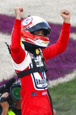 Kyle Larson celebrates at the finish line after winning a NASCAR Cup Series auto race Sunday, June 20, 2021, in Lebanon, Tenn. (AP Photo/John Amis)