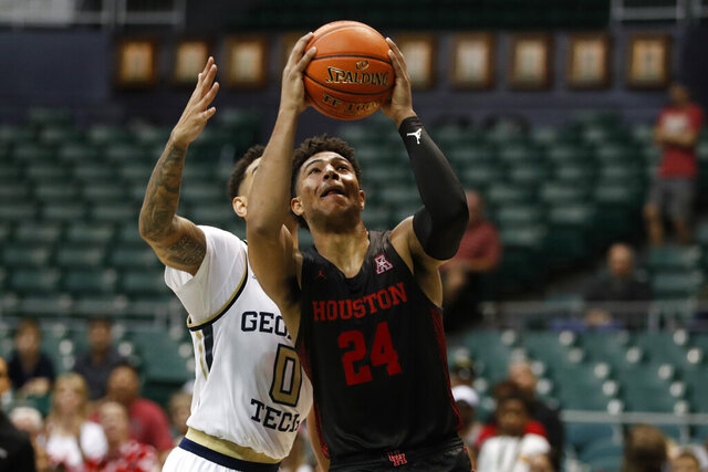Houston guard Quentin Grimes goes to the basket, in front of Georgia Tech guard Michael Devoe (0) during the second half of an NCAA college basketball game Monday, Dec. 23, 2019, in Honolulu. (AP Photo/Marco Garcia)