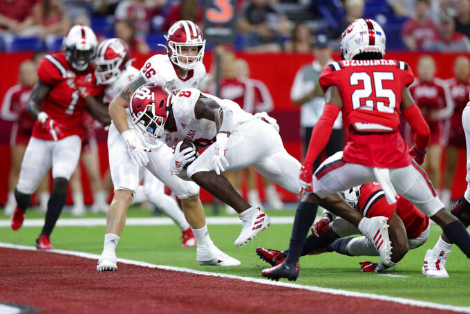 Indiana running back Stevie Scott III (8) dives in for a touchdown against Ball State during the second half of a college football game in Indianapolis, Saturday, Aug. 31, 2019. Indiana defeated Ball State 34-24. (AP Photo/Michael Conroy)