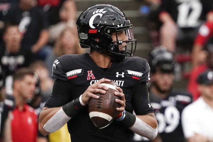 Cincinnati quarterback Desmond Ridder drops back for a pass during the second half of an NCAA college football game against Miami (Ohio), Saturday, Sept. 4, 2021, in Cincinnati. (AP Photo/Jeff Dean)
