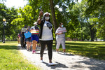 In this Friday, June 19, 2020, photo Jeannine Lee Lake, Democratic candidate for Indiana's 6th congressional district, leads a march to honor George Floyd during a Juneteenth day event in Columbus, Ind. Lake never would have imagined when she first ran against Greg Pence, Vice President Mike Pence's brother, for a rural Indiana congressional seat two years ago: An almost entirely white crowd of more than 100 people marching silently in the Pences' hometown, sending up prayers for Black people killed by police and an end to systemic racism. Leading them was Lake, who has launched a rematch against Pence. She is the only Black woman running for federal office in Indiana this fall. (AP Photo/Michael Conroy)