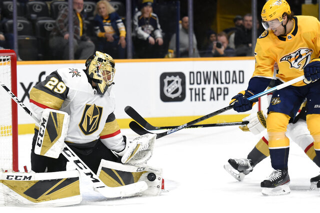 Vegas Golden Knights goaltender Marc-Andre Fleury (29) blocks a shot by Nashville Predators right wing Craig Smith (15) during the second period of an NHL hockey game Saturday, Feb. 1, 2020, in Nashville, Tenn. (AP Photo/Mark Zaleski)