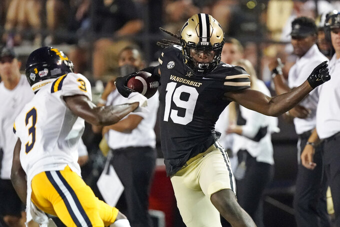 Vanderbilt wide receiver Chris Pierce Jr. (19) tries to evade East Tennessee State defensive back Tyree Robinson (3)in the first half of an NCAA college football game Saturday, Sept. 4, 2021, in Nashville, Tenn. (AP Photo/Mark Humphrey)