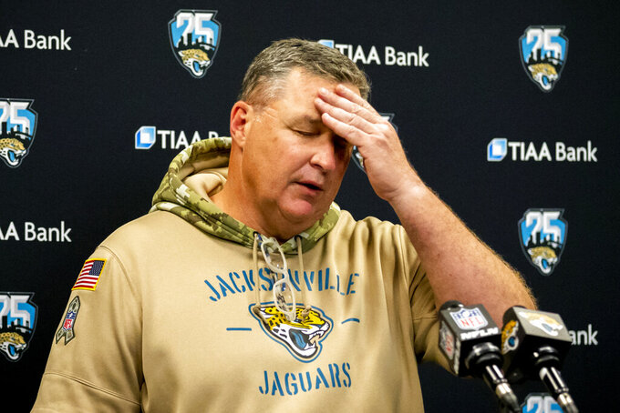 FILE - Jacksonville Jaguars head coach Doug Marrone speaks to members of the media during a post-game press conference after an NFL football game between the Jaguars and the Tampa Bay Buccaneers in Jacksonville, Fla., in this, Sunday, Dec. 1, 2019, file photo. The Jaguars have fired coach Doug Marrone a little more than 12 hours after ending the season with a 15th consecutive loss. It was a move many thought owner Shad Khan should have made at the end of 2019. The Jaguars canceled Marrone's season-ending news conference scheduled for Monday, Jan. 4, 2021. (AP Photo/Stephen B. Morton, File)