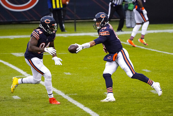 Chicago Bears quarterback Mitchell Trubisky (10) hands off to wide receiver Cordarrelle Patterson (84) on his way to a touchdown against the Detroit Lions in the first half of an NFL football game in Chicago, Sunday, Dec. 6, 2020. (AP Photo/Charles Rex Arbogast)